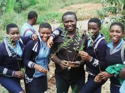 Farmer Tantoh encouraging students to plant trees